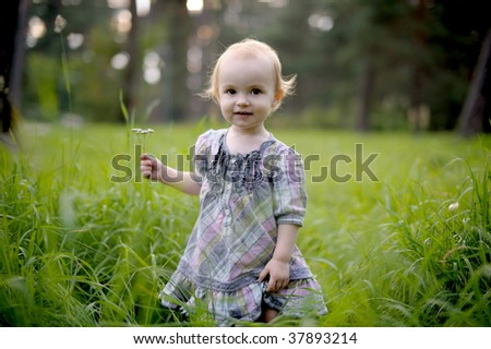 Smiling little baby girl wearing nice dress