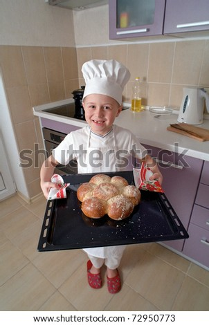 smiling little baker - stock photo