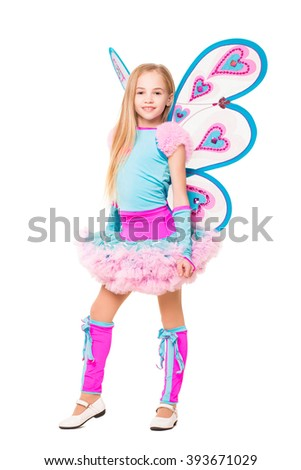 Smiling little blond girl posing in butterfly dress. Isolated on white - stock photo