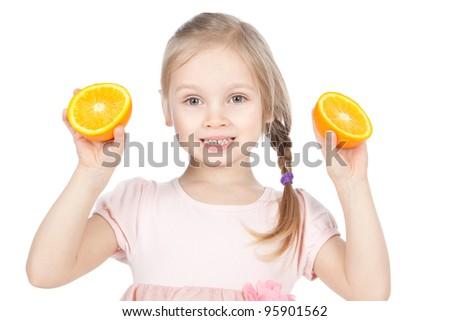 Smiling little blonde girl holding fresh oranges over white - stock photo