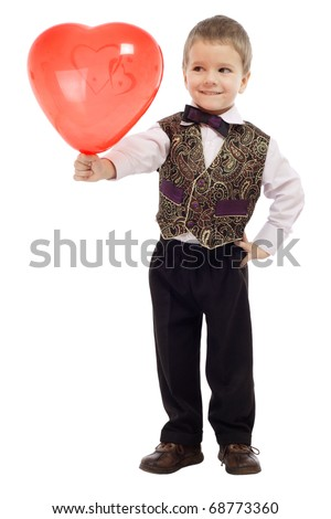Smiling little boy gives a red balloon, isolated on white - stock photo