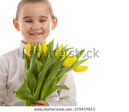 smiling little boy giving tulips  - stock photo