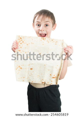 Smiling little boy holding a lavash on a white background - stock photo
