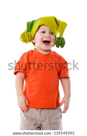 Smiling little boy in funny hat, isolated on white - stock photo