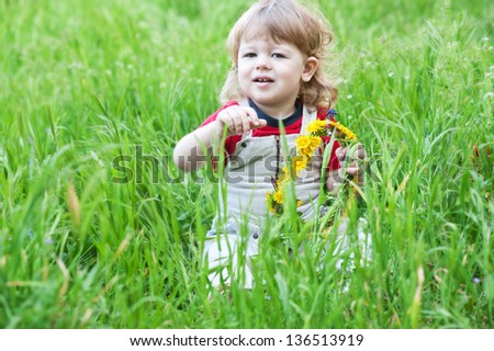 Smiling little boy in park - stock photo