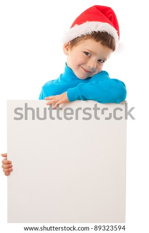Smiling little boy in Santa's hat with empty vertical banner, isolated on white