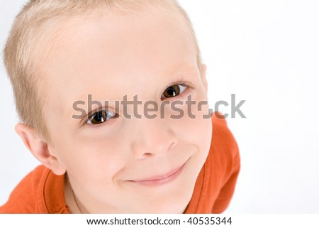 Smiling little boy on a white background