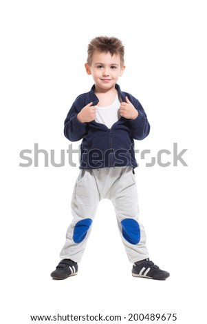 Smiling little boy posing in sport clothes. Isolated on white - stock photo