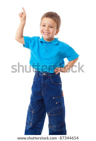 Smiling little boy with empty pointing hand, isolated on white - stock photo