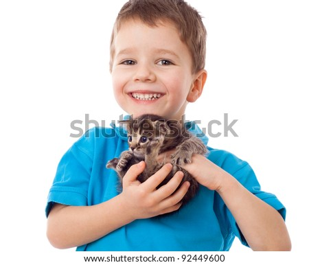 Smiling little boy with kitty in hands, isolated on white - stock photo