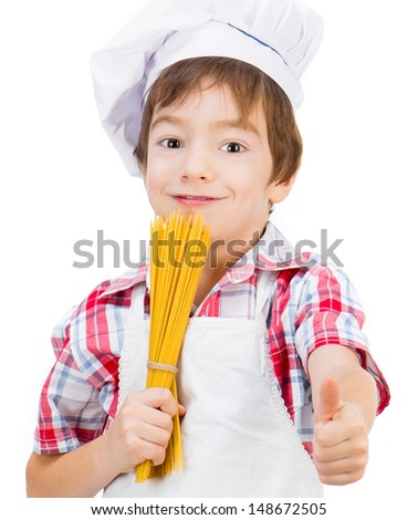 smiling little boy with raw spaghetti with thumbs up - stock photo