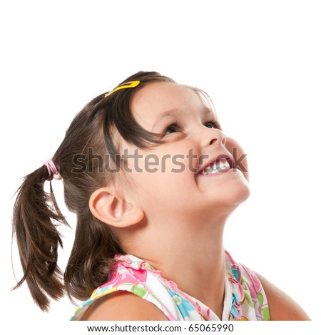 Smiling little child looking up at copyspace isolated on white background - stock photo