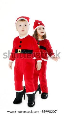 Smiling little children in Christmas uniform isolated on white - stock photo
