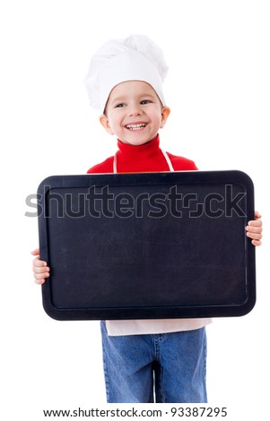Smiling little cooker with empty horizontal chalkboard, isolated on white - stock photo