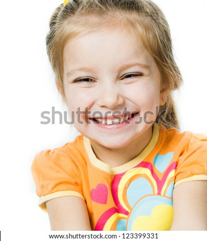 Smiling little girl a on white background - stock photo