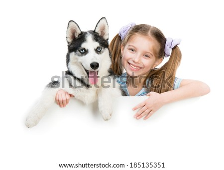 smiling little girl and dog Husky with white cardboard - stock photo