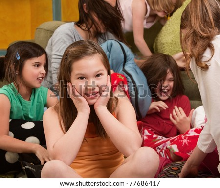 Smiling little girl at a sleepover with her friends - stock photo