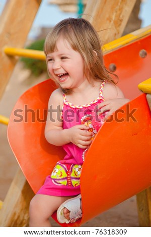Smiling little girl at playground - stock photo