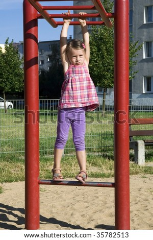 smiling little girl at the playground - stock photo