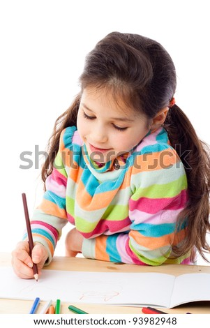 Smiling little girl at the table drawing the cat with crayons, isolated on white - stock photo