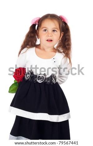 Smiling little girl hiding red rose - stock photo