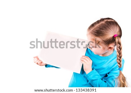 Smiling little girl holding an empty white card for you sample text isolated on white - stock photo