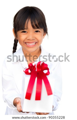 Smiling little girl holding and offering a gift, Isolated on white background - stock photo