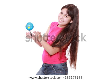 Smiling little girl holding and offering globe/Cute and confident young preteen girl holding the world globe in her hands - stock photo
