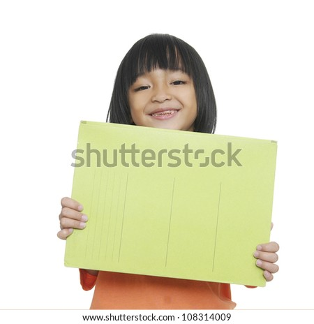 Smiling little girl holding empty green board - stock photo