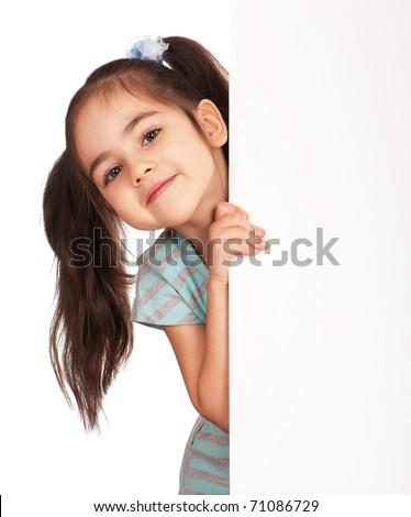 Smiling little girl holding empty white board - stock photo