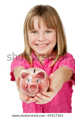 Smiling little girl holding piggy bank isolated on white - stock photo