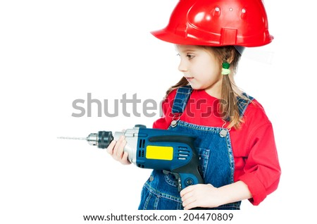 Smiling Little girl in a red helmet with drill isolated on a over white - stock photo