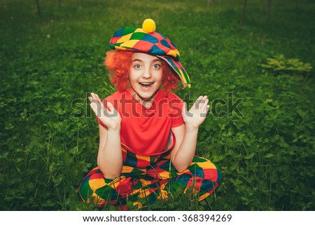 smiling little girl in clown wig
