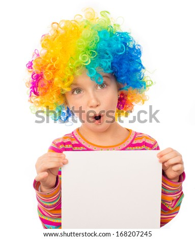 smiling little girl in clown wig with white blank isolated on white background - stock photo