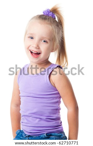 smiling little girl in purple t-shirt and jeans isolated