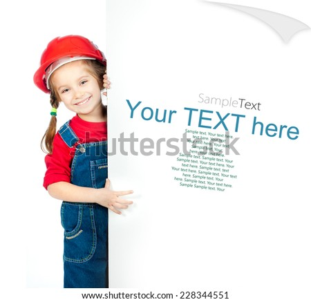 smiling little girl in the construction helmet and white board with sample text - stock photo