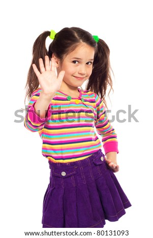Smiling little girl showing her hand up, isolated on white - stock photo