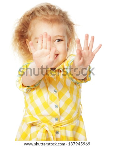 Smiling little girl showing her hands up, isolated on white