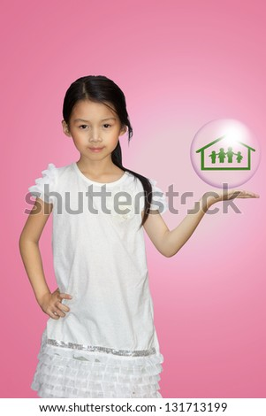 Smiling little girl showing on family symbol over simply background - stock photo