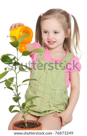 Smiling little girl watering the plant with yellow can isolated on white - stock photo