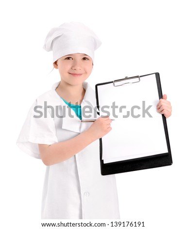 Smiling little girl wearing as a nurse on white uniform pointing with pen on a blank medical report. Isolated on white background. - stock photo
