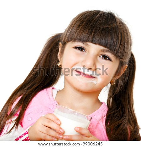 smiling little girl with a glass of milk - stock photo
