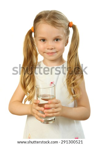 smiling little girl with a glass of water on a white background - stock photo