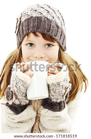 Smiling little girl with a white cup of hot drink. Isolated on white background  - stock photo