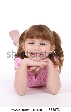 smiling little girl with  chin on her hands
