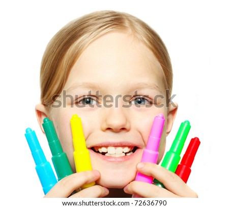 Smiling little girl with colorful felt pens in hands - stock photo