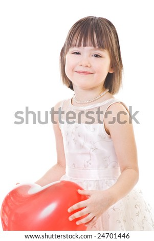 Smiling little girl with ed heart-shaped balloon in hands - stock photo