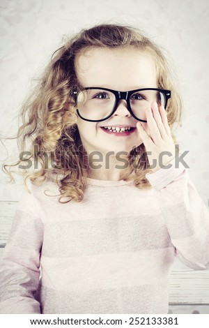 Smiling little girl with glasses - stock photo