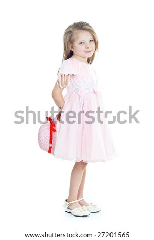 Smiling little girl with hat wearing pink dress - stock photo