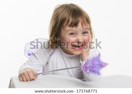 Smiling little girl with magic wand - stock photo